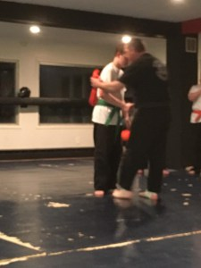 My son after passing his test, and while receiving his green belt